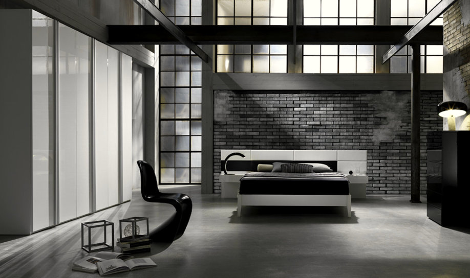 ... letto composta da pannelli in ecopelle bianca alternati al lucido nero